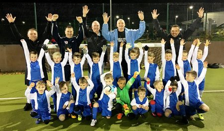 Bradley Stoke Youth FC's U6 team players and coaches celebrate receiving a brand new free kit courtesy of local McDonald's franchisee Mike Guerin.