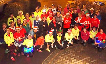 Members of Sole Sisters Running Club on a Christmas-themed training run.