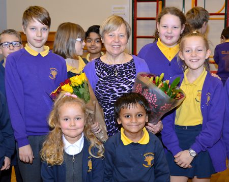 Christine Dursley (centre) headteacher of Wheatfield Primary School, on her retirement after 18 years in the post. She is pictured with pupils who played leading roles in a special farewell assembly held on Thursday 15th December 2016.