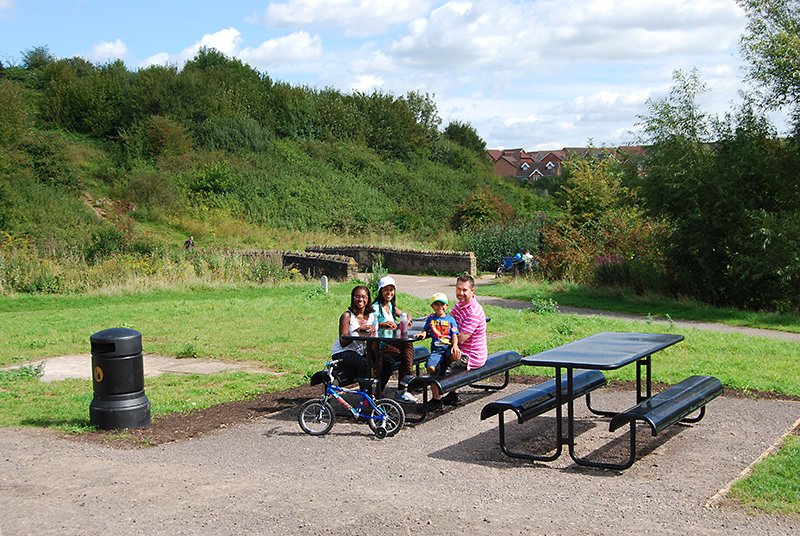 Picnic tables near the 'duck pond' in the Three Brooks Local Nature Reserve, Bradley Stoke.