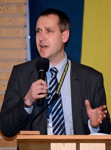 Temporary Detective Chief Inspector Dom Graham address a public meeting called to discuss a surge of burglaries in Bradley Stoke.