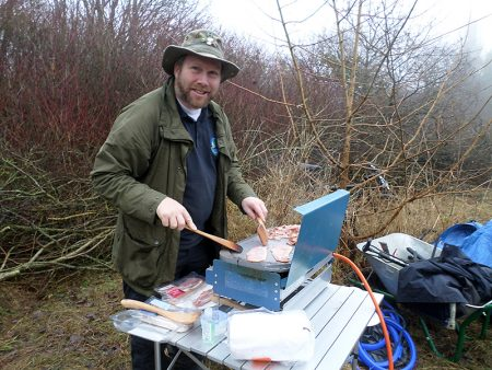 Rob Williams cooks hot food for the workers during the Three Brook Nature Conservation Group's hedgelaying weekend.
