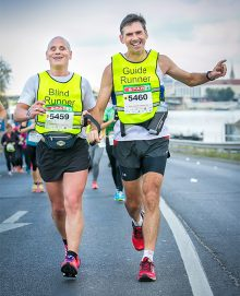 Blind runner Chris Blackabee competing in the 2016 Budapest Marathon with his guide Colin Johnson.