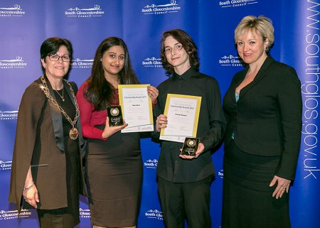 Photo of Diya Barot and George Beaven receiving their awards.