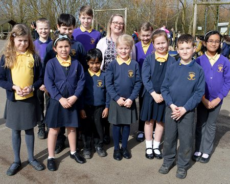 Photo of pupils and headteacher at Wheatfield Primary School.
