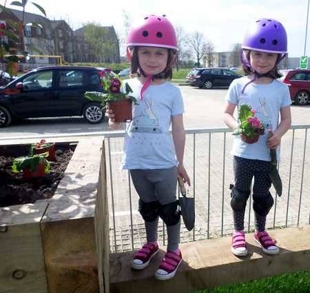 Photo of Lola and Darcy helping Bradley Stoke in Bloom volunteers at the skate park.
