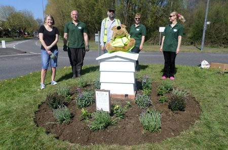 Photo of Bradley Stoke in Bloom volunteers on Sherbournes Brake Roundabout.