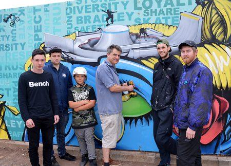 Photo of a community art panel being installed at Bradley Stoke Skate Park.