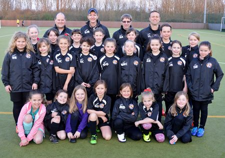 Photo of Bradley Stoke Youth FC girls in training kit sponsored by AV Birch Limited.