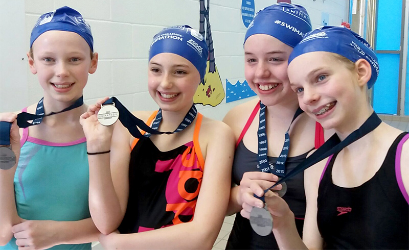 Photo of the four girls with their medals.