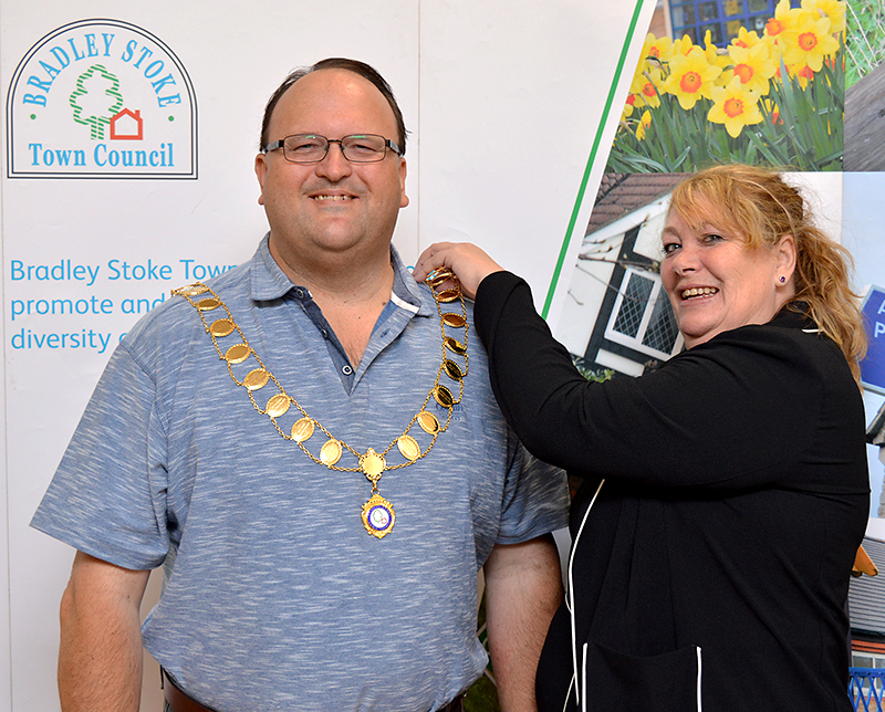 Newly-elected Mayor of Bradley Stoke Cllr Andy Ward (left) receives the chain of office from previous mayor Cllr Elaine Hardwick.