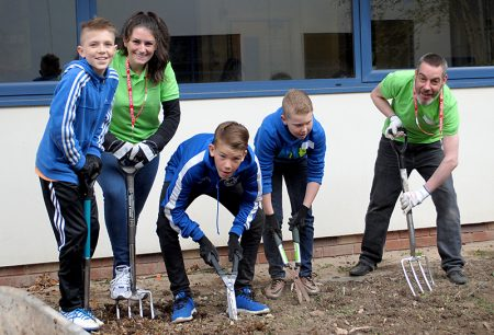 Volunteers from Boeing Defence working with students at Bradley Stoke Community School on a World Earth Day project.
