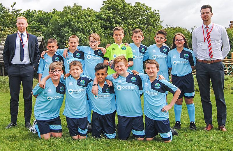 Meadowbrook Primary School's football team, sponsored by Ocean.