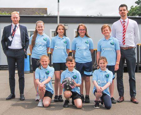 Meadowbrook Primary School's netball team, sponsored by Ocean.