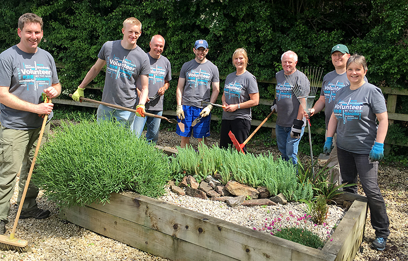 Photo of Mercer employees helping to maintain the grounds at the West of England MS Therapy Centre.