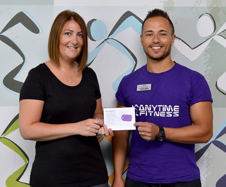 Photo of Emma Tibbott receives her membership key from Lewis Erskine.