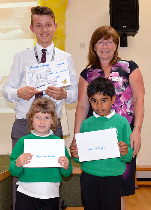 Photo of Maja Lamberska (left) and Ashmas Rizvi receiving their colouring competition prizes.
