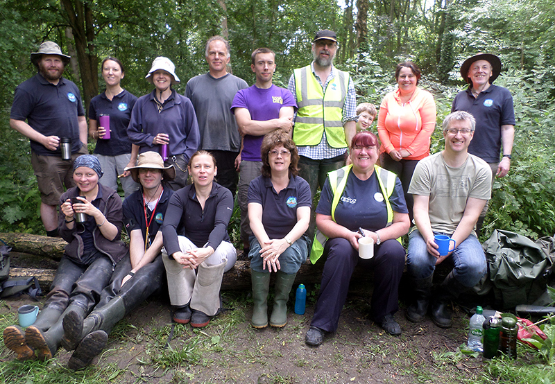 Photo of volunteers from the Three Brooks Nature Conservation Group taking a tea break.