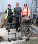 Photo of Tesco community champion Dawn Richards (left) and other volunteers from the Three Brooks Nature Conservation Group with two Tesco shopping trolleys recovered from brooks in the nature reserve.