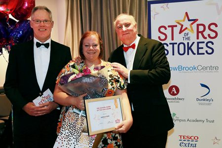 Photo of Jessica Stone receiving her award.