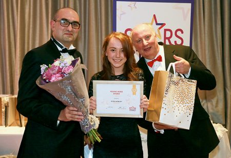 Photo of Kyra Morley receiving her award.