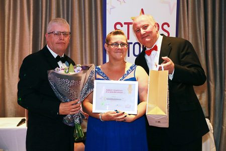 Photo of Samantha Bigwood receiving her award.