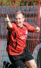 Ben Hiscox celebrates scoring a goal for Manor Farm in the FA Cup.