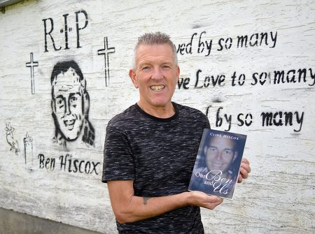 Photo of Clive Hiscox at the Trust Ground with a copy of the book he has written.