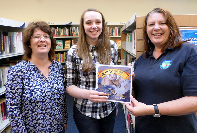 Photo of Conservation group members presenting a copy of 'Bobby the Brown Long-Eared Bat'' to the library.