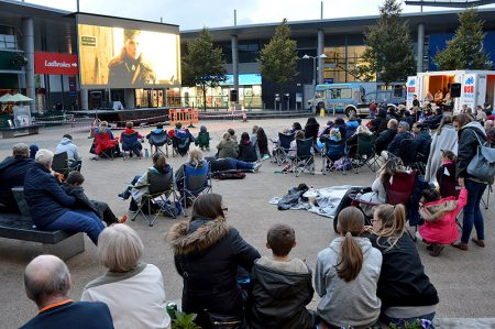 Photo of crowd and screen at the 'Movies in the Square' event.