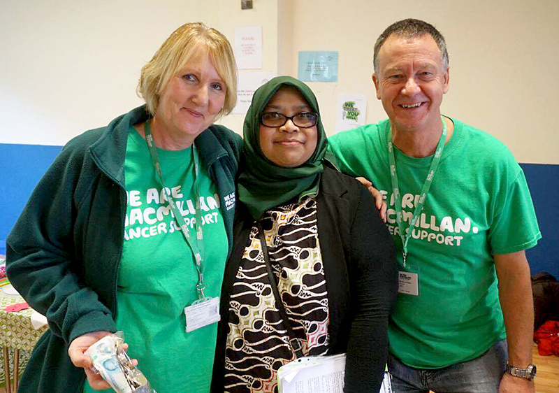 Photo of Opy Sufinar (centre) with Macmillan representatives Suzanne and Steve Killeen.