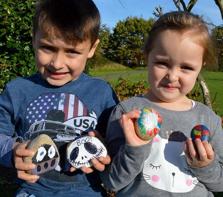 "Charlie & Immy Wheeler show off some of the ""rocks"" they have decorated."