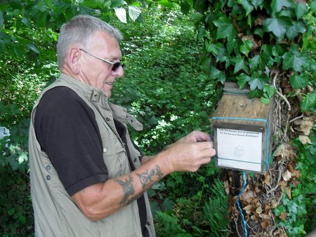 Photo of Colin Davies repairing a dormouse box .