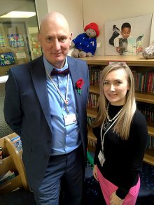 Photo of Dave Baker with Amelia Newport at Charborough Road Primary School.