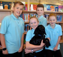 Photo of Year 7 students with Wally the Dog.