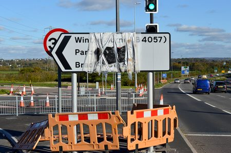 Photo of covered-up road sign at the junction of the new Stoke Gifford By-Pass with the A4174 Ring Road near UWE.