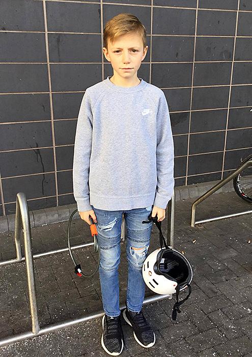 Photo of Josh Harding holding a bike helmet and bike lock.