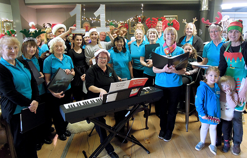 Photo of Stokes Singers performing at Poplars Farm Shop.