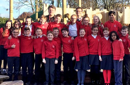 Photo of pupils and staff celebrating the school's recent 'good' report.