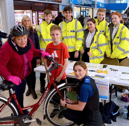 Photo of local resident Nicky Tregenza having her bike security marked by PCSO Alicia Harvey.