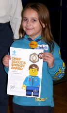 Photo of Calleigh Pace with her Chief Scout's Bronze Award certificate.