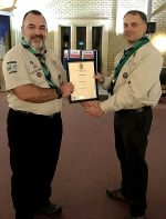 Photo of Dave Pace (right) receiving his award from Clive Mason.