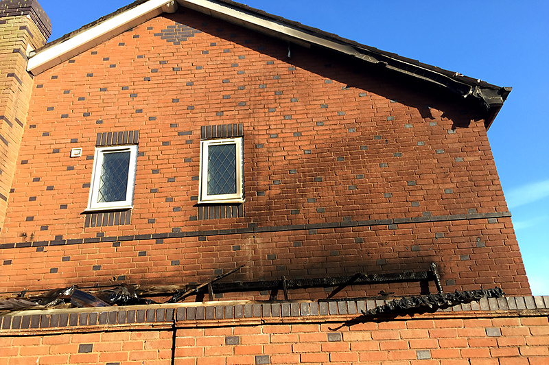 Photo of fire damage on the gable end.
