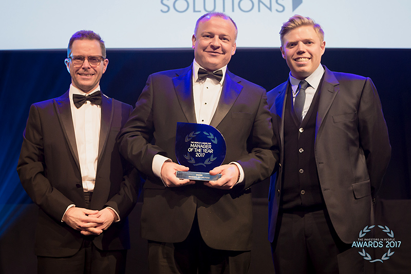 Photo of Jim Roach receiving his award.