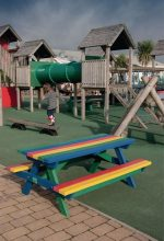 Rainbow picnic bench, manufactured from 100% plastic waste.