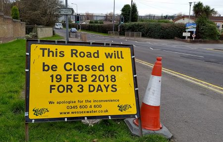 Photo of a road sign informing of a road closure on Woodlands Lane.