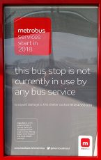 "Poster in MetroBus Shelter: ""This bus stop is not currently in use by any bus service""."
