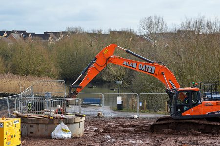 Photo of an excavator at the Wessex Water tunnelling compound.