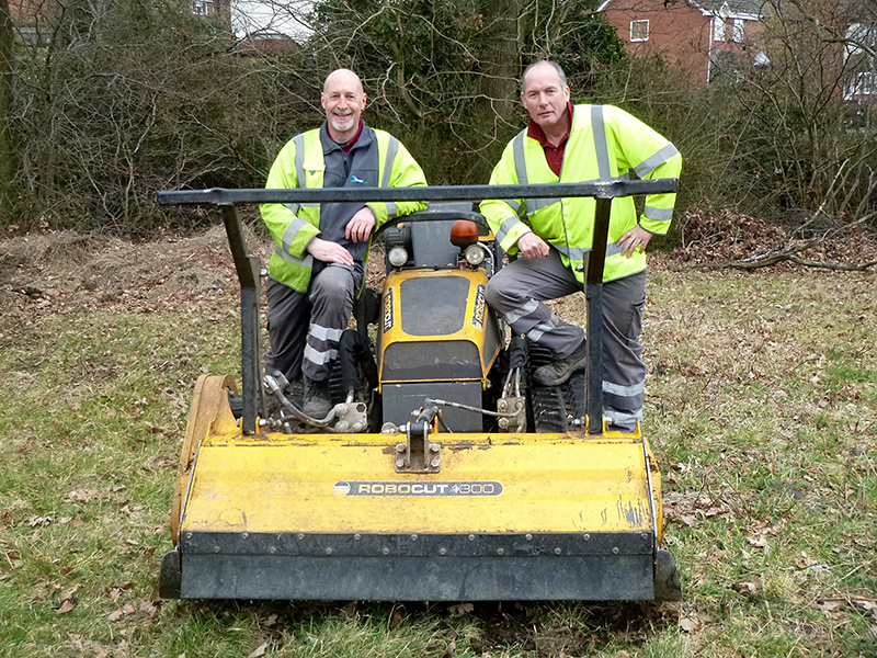 Photo of volunteers with a Robocut machine brought in to clear scrub.