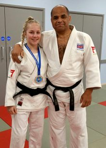 Photo of Tatum Keen, wearing her Croatia Cadet Cup silver medal, with coach Pete Douglas.